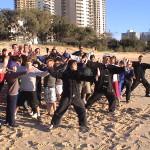 Tai Chi Class Sufers On the Beach